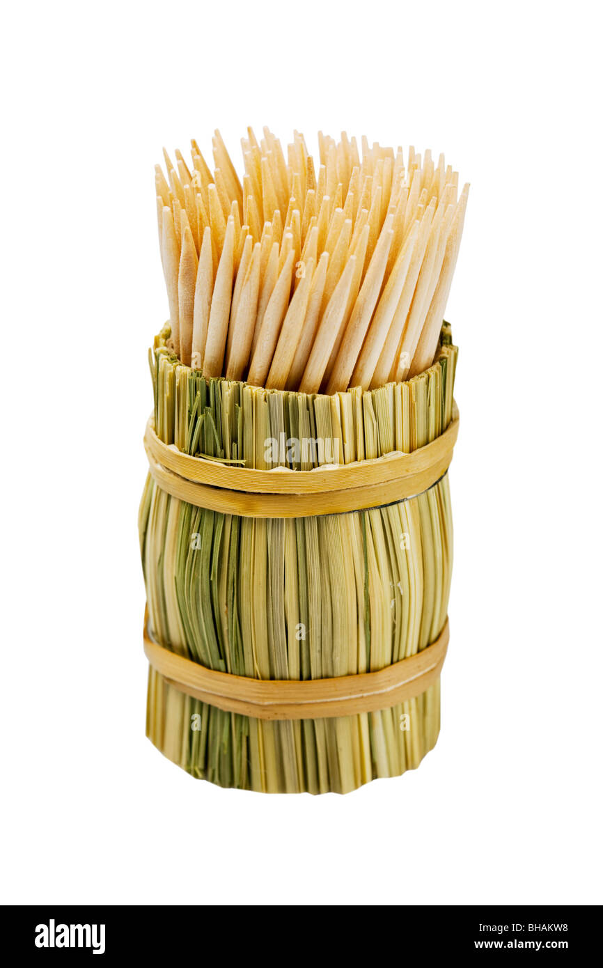 Wooden toothpicks in a wattled glass. - Stock Image