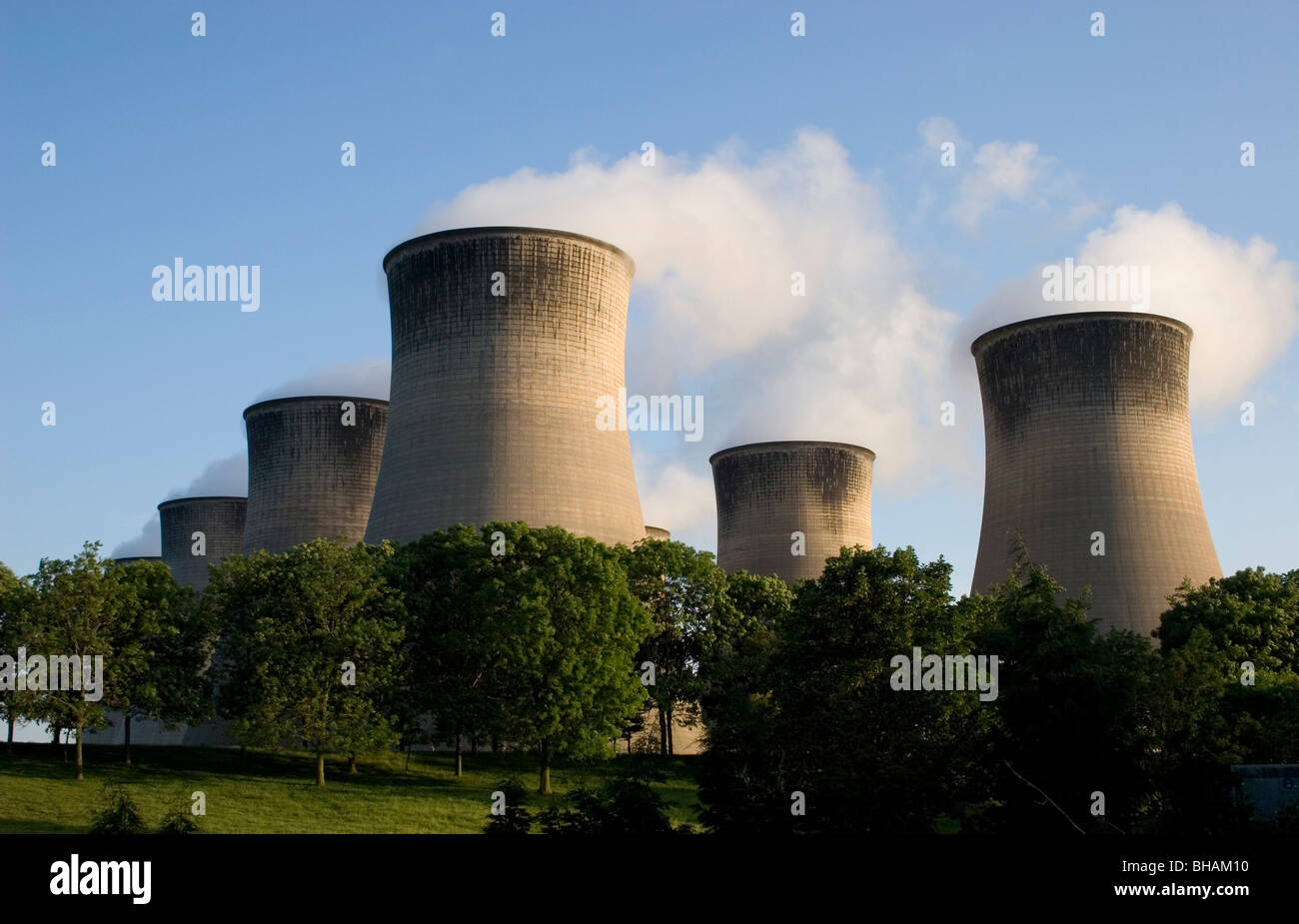 industrial chimneys billowing out smoke, northern England - Stock Image