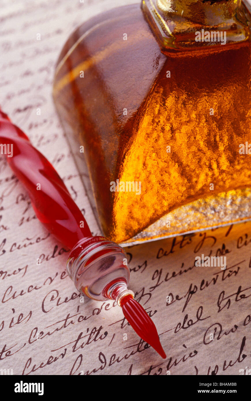 Red glass pen and gold ink on old letter - Stock Image