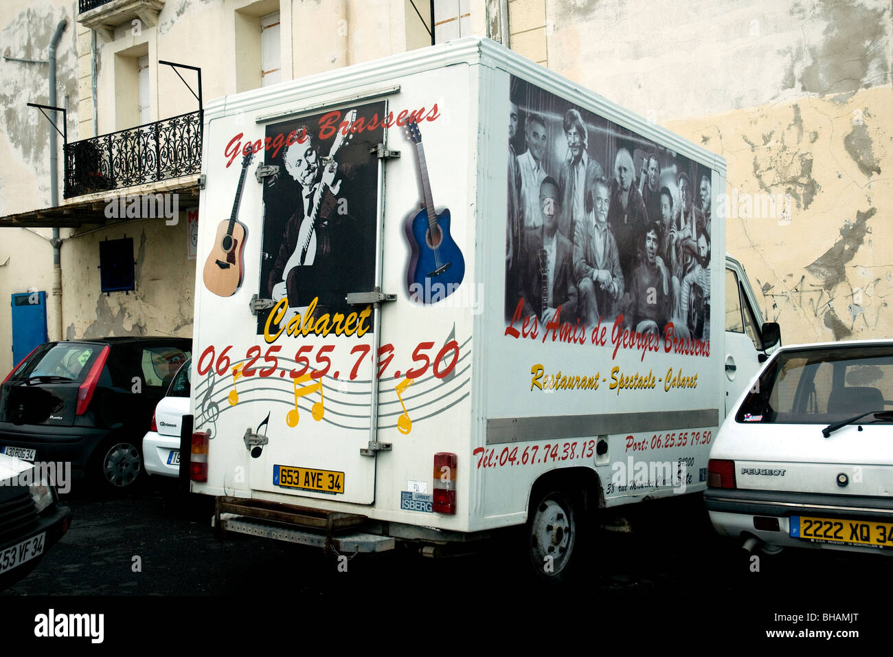 A van parked in a Sète side street evokes the continuing popularity of the late poet-musician Georges Brassens, - Stock Image