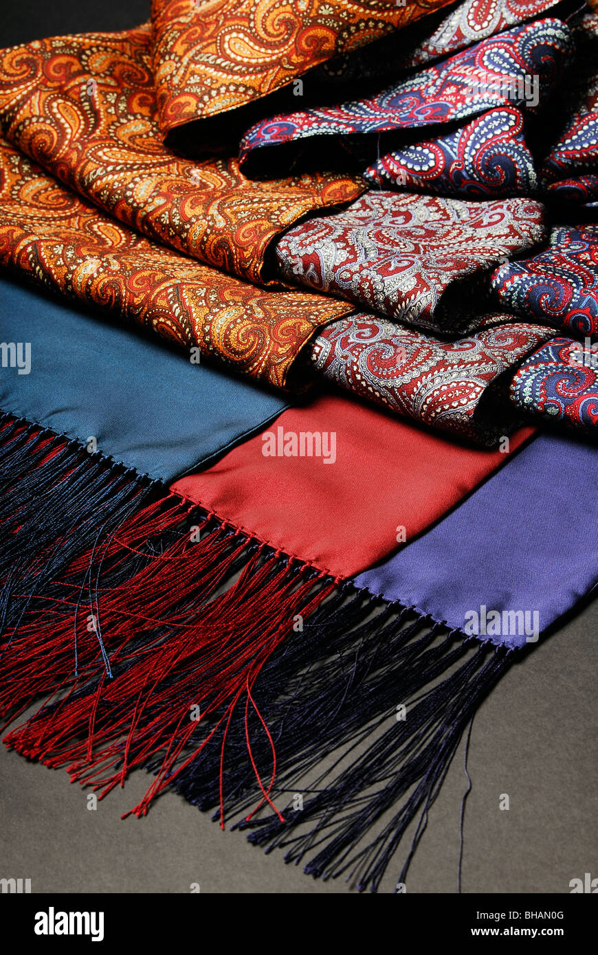 Three silk paisley scarves on a black background - Stock Image