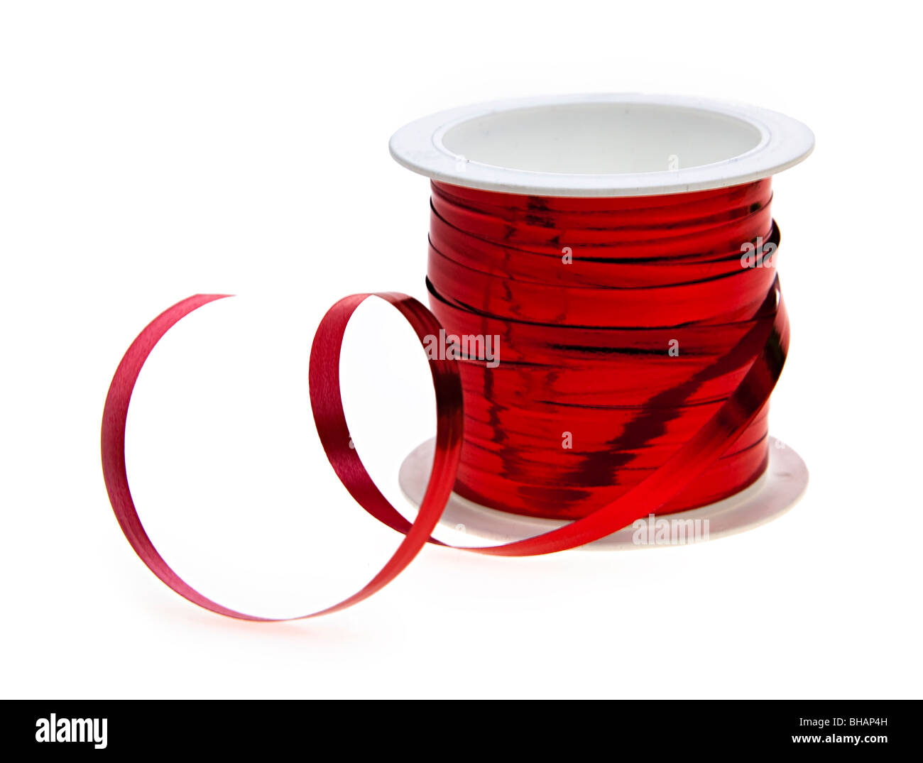 Red ribbon on spool - Stock Image