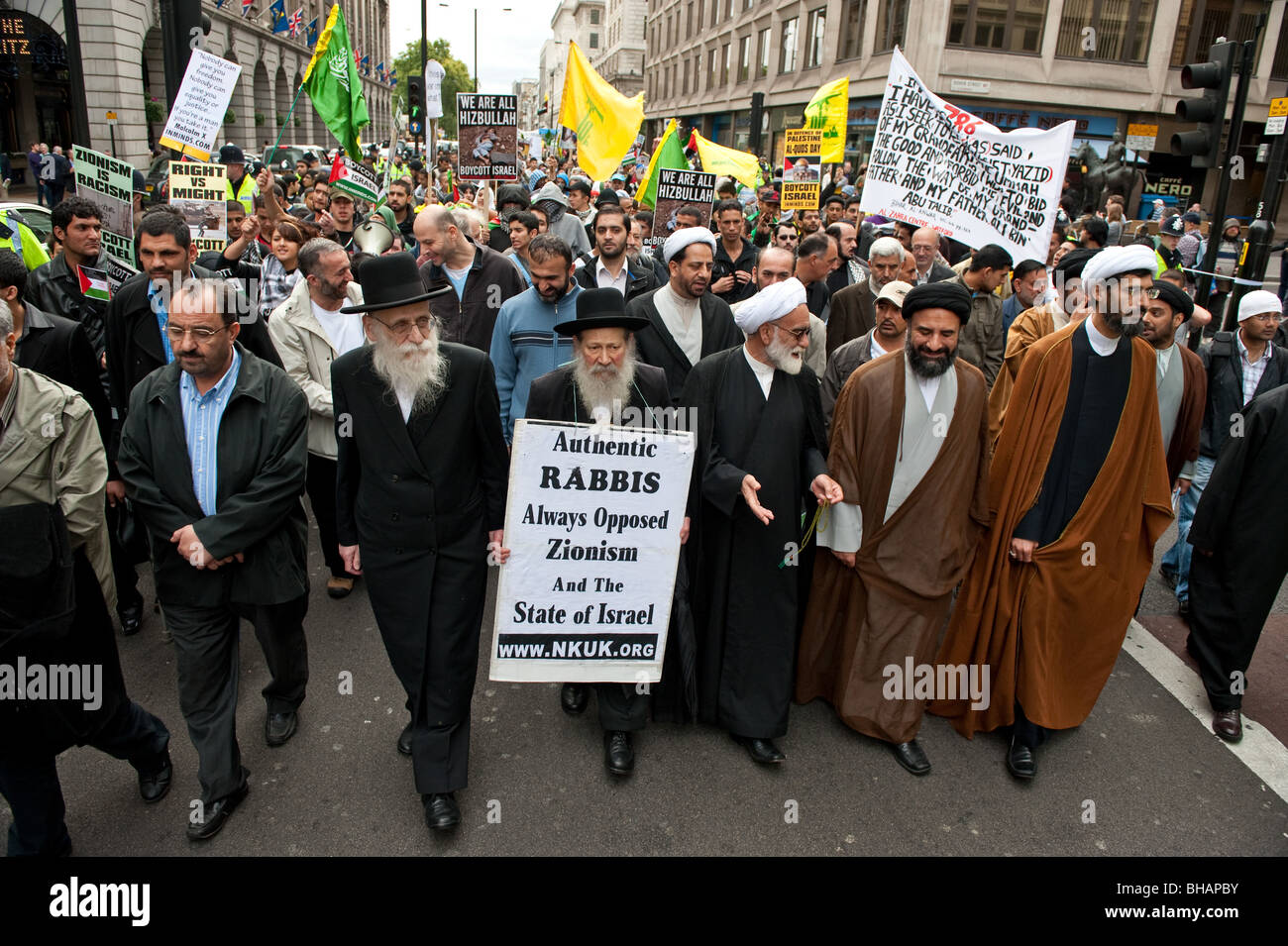 Rabbis and Islamic clerics marching together at the Annual Al Quds Demonstration in support of the Palestinian people. - Stock Image