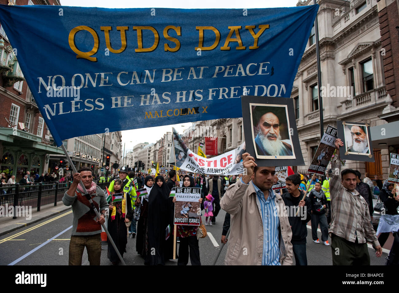 Demonstrators marching  at the Annual Al Quds Demonstration in support of the Palestinian people. - Stock Image