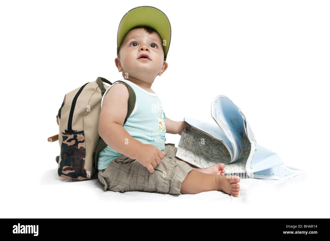 Baby boy with backpack and map - Stock Image