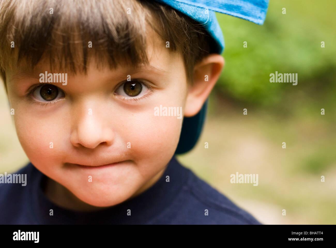 boy looking innocent - Stock Image