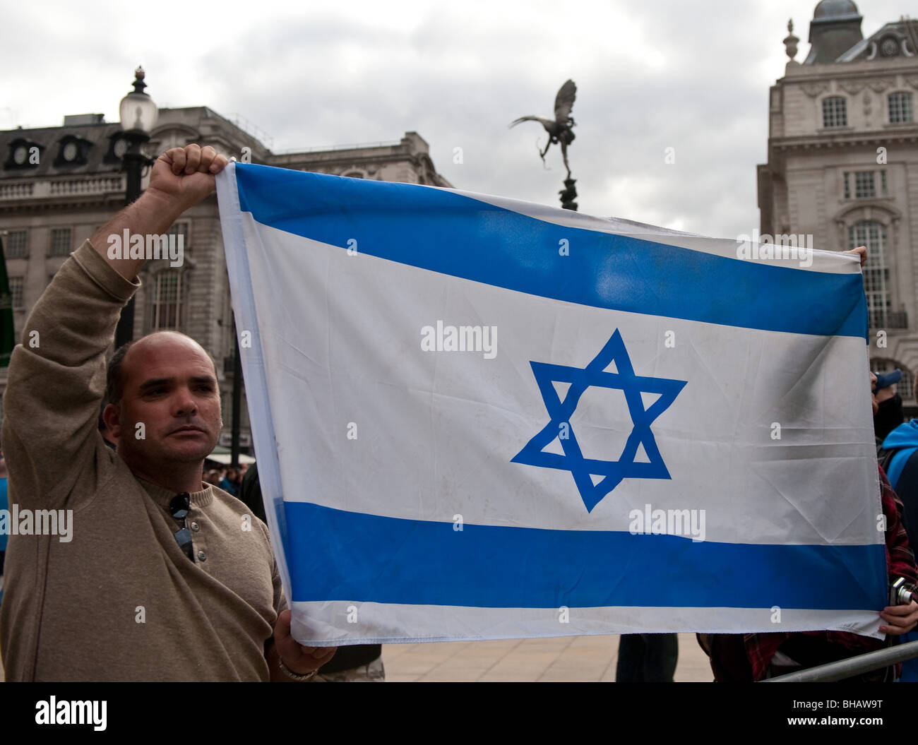 Men carrying an Israeli flag at the Annual Al Quds Demonstration in support of the Palestinian people. - Stock Image