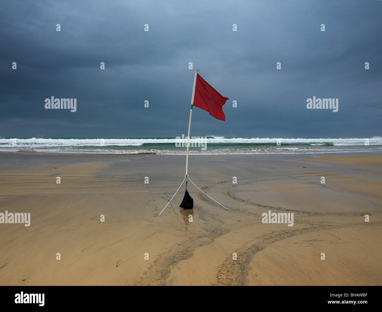 Unsafe bathing flag, Gwithian Towans, Cornwall, UK Stock Photo