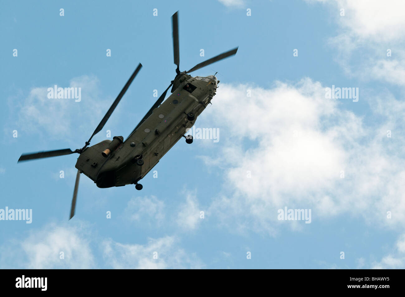 Chinnok helicopter with steep climbing angle of attack during aerobatic display at RAF Waddington Airshow - Stock Image
