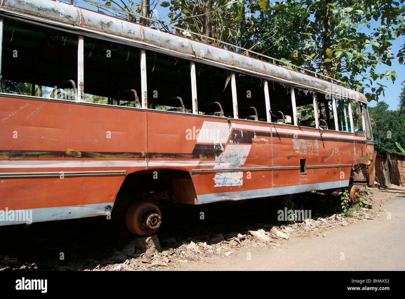 A poor wrecked old Bus parked nearby road side - Stock Image