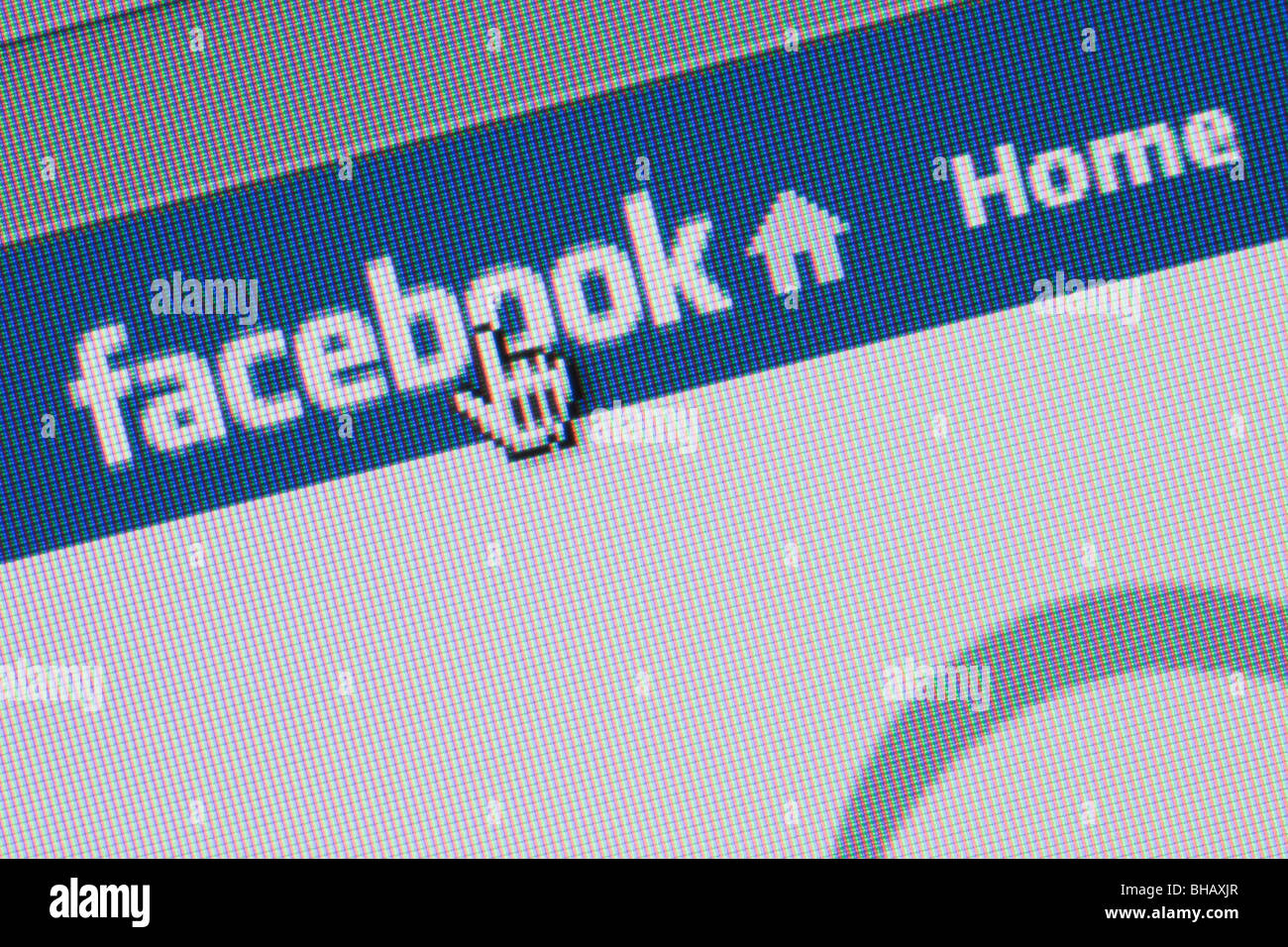 Close-up screenshot of Facebook social networking website logo on home page with cursor pointing. England UK Britain - Stock Image