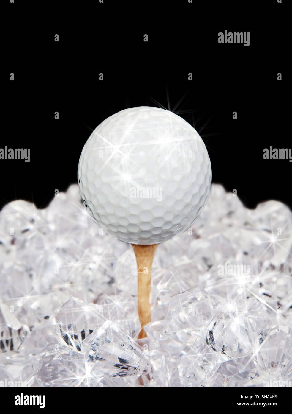 ultimate golf sparkling ball on tee amongst diamonds - Stock Image