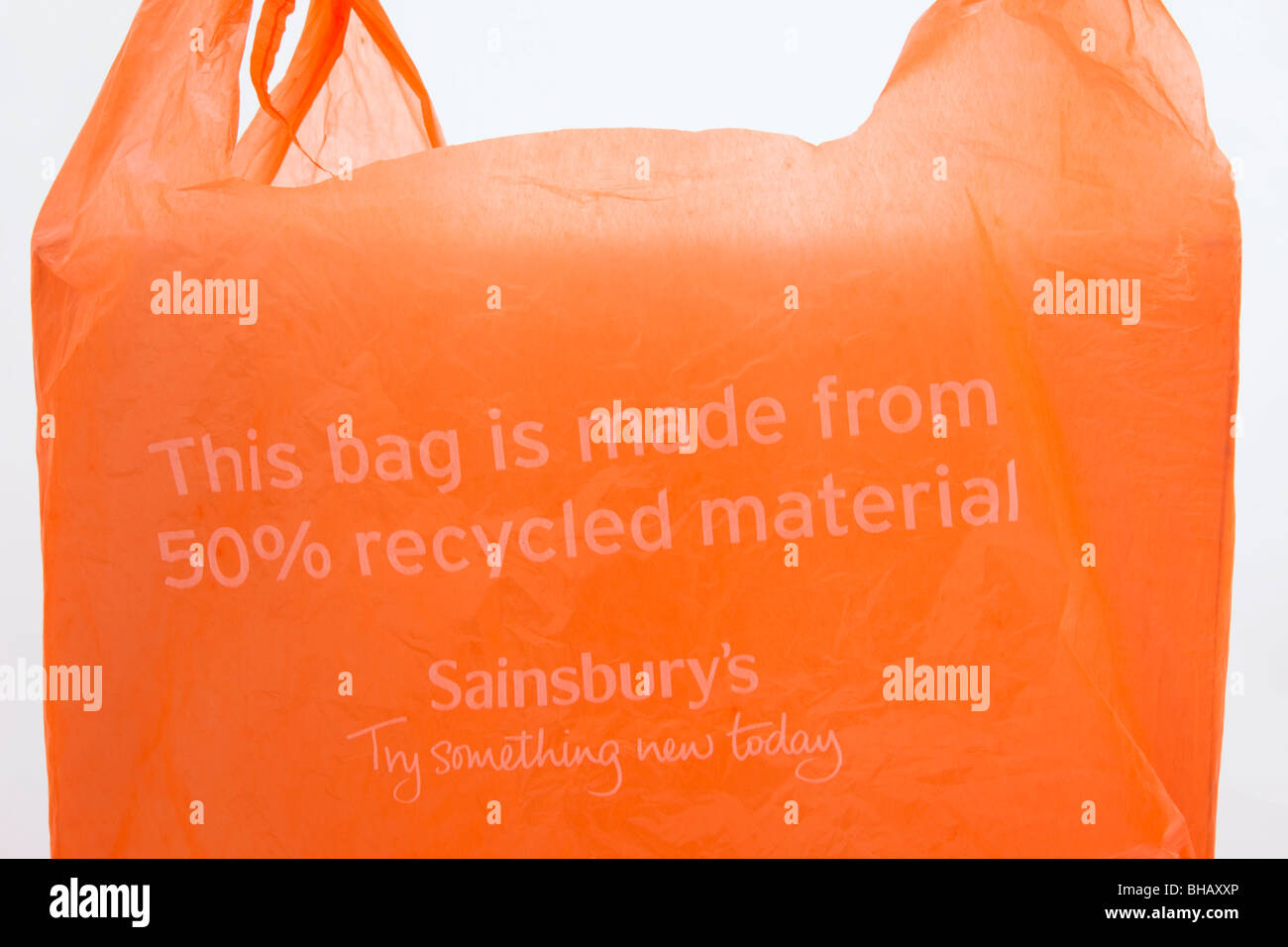 Sainsbury's single-use plastic carrier bag made from 50% recycled materials. England, UK, Britain - Stock Image