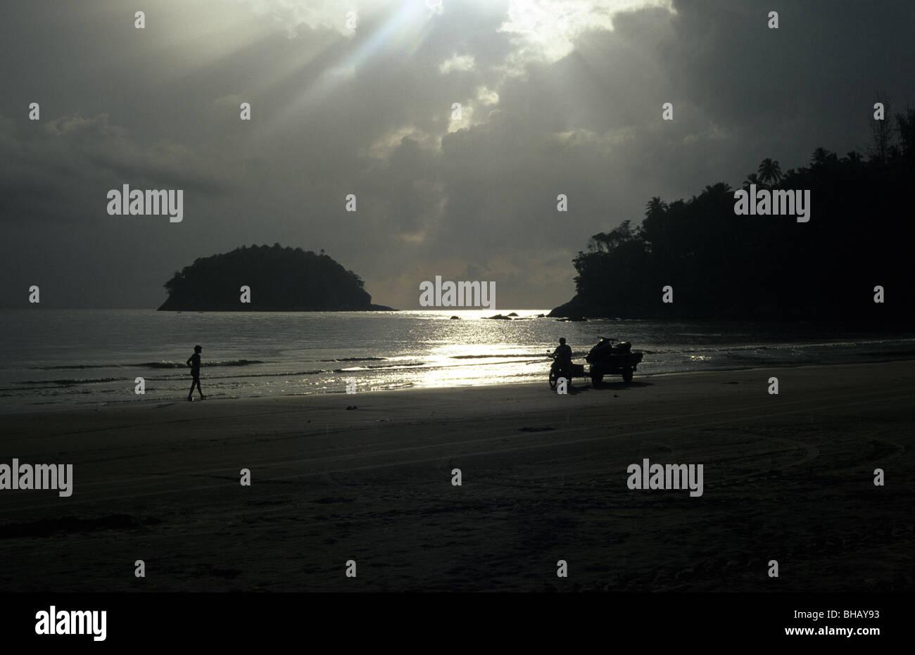 Sunsetting on Karon Beach in Phuket, Thailand Stock Photo