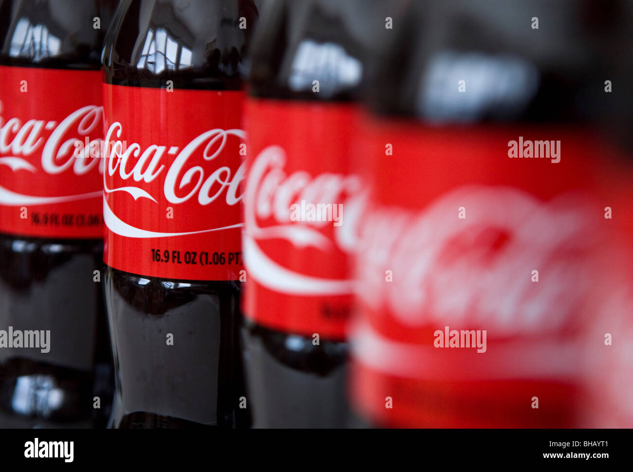 A grouping of Coca-Cola bottles.  - Stock Image