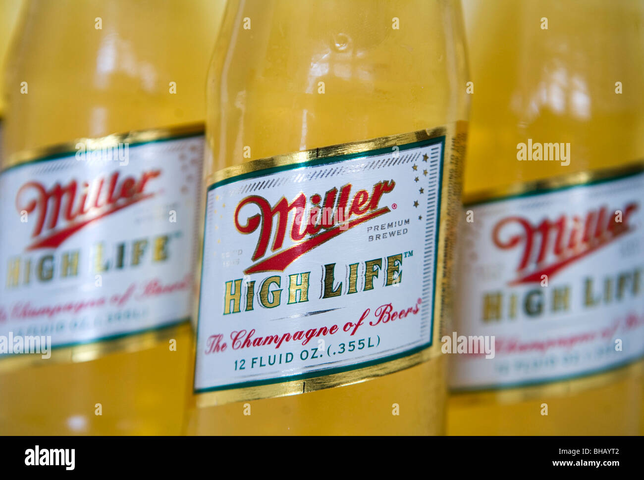 A grouping of Miller High Life Beer Bottles.  - Stock Image