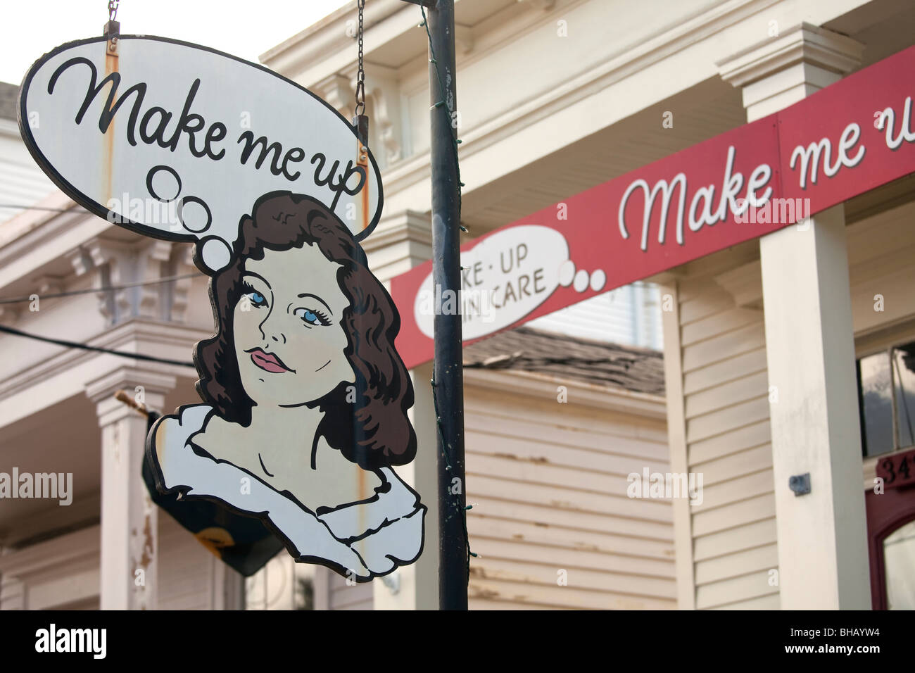 Beauty salon sign of a woman and entrance to salon housed in one of the beautiful old buildings on Magazine Street, - Stock Image