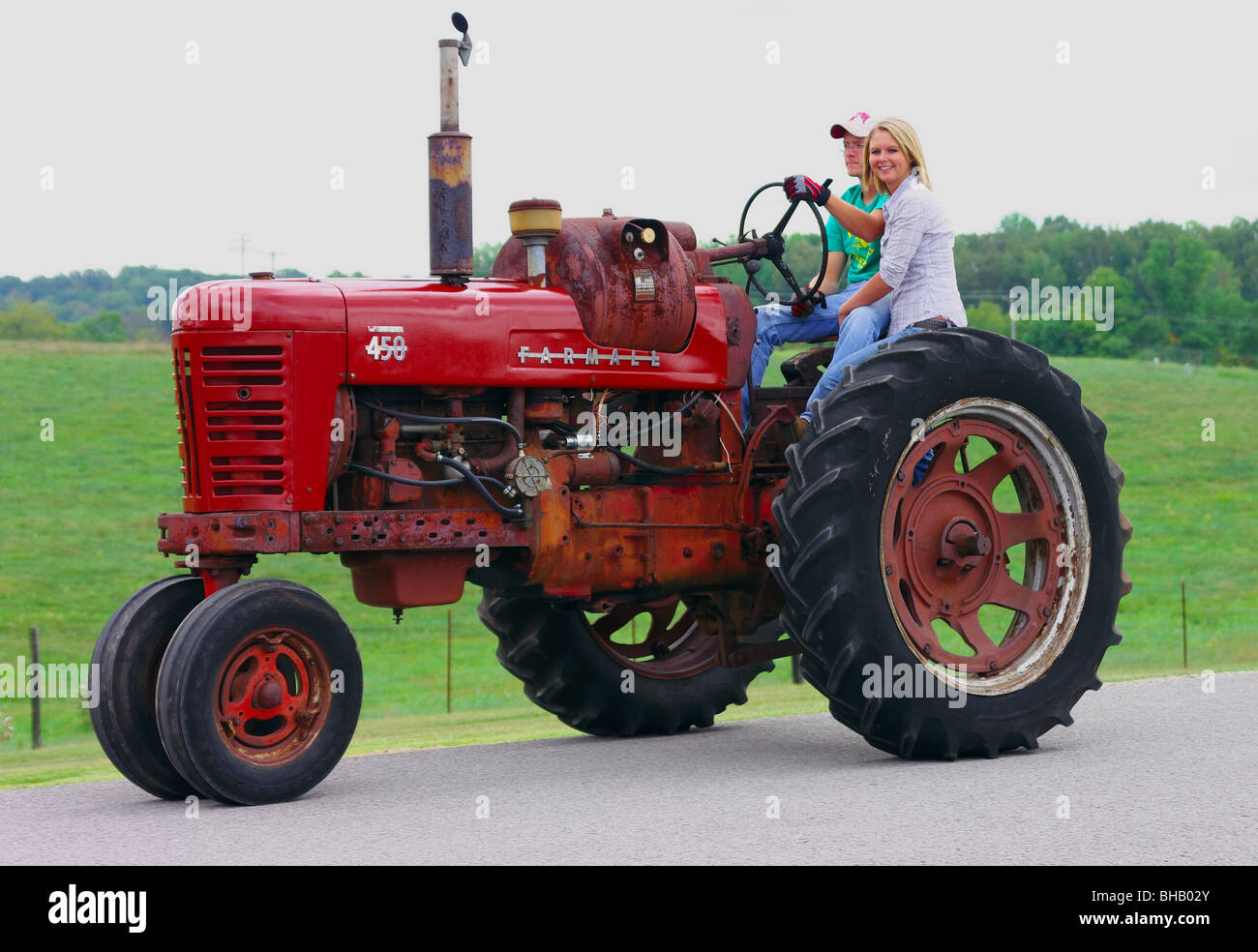 Guy On Tractor : Farmall stock photos images alamy