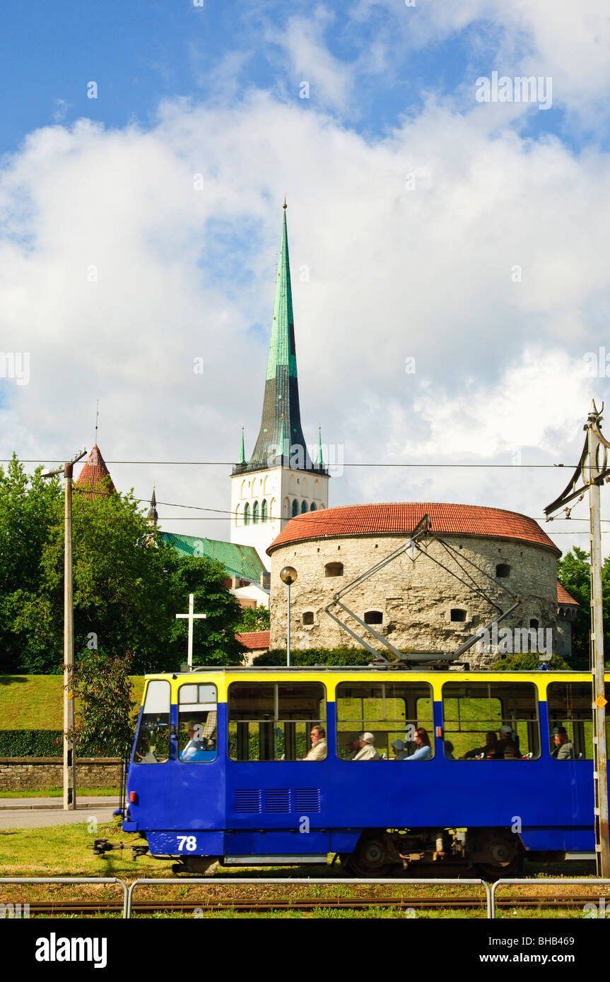 Tram in Tallinn, Estonia. Behind are the tower called Paks Margareta (Fat Margaret) and the 124m tall spire of St - Stock Image