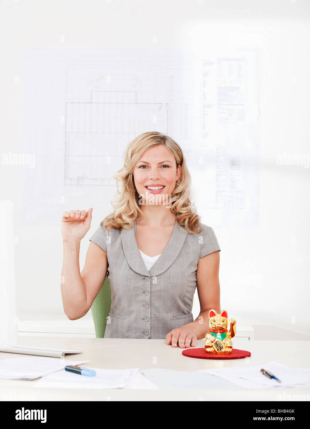 Businesswoman with good luck charm - Stock Image