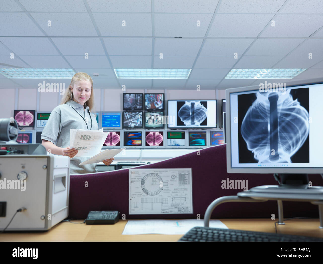 Female Fusion Scientist With Screens - Stock Image