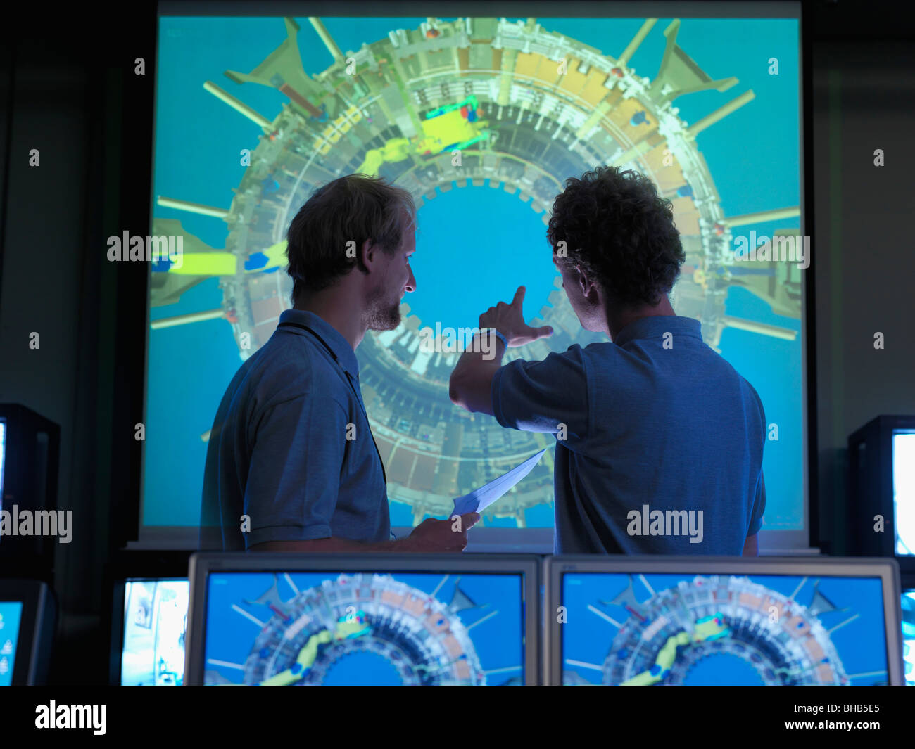 Fusion Reactor Scientists With Screens - Stock Image