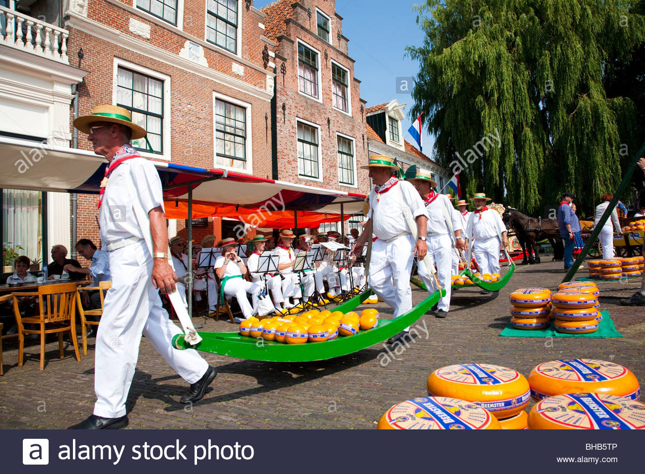 adult Benelux cheese Cheese Market cheeses cultural culture Dutch Edam Europe Holland human humans male man men - Stock Image