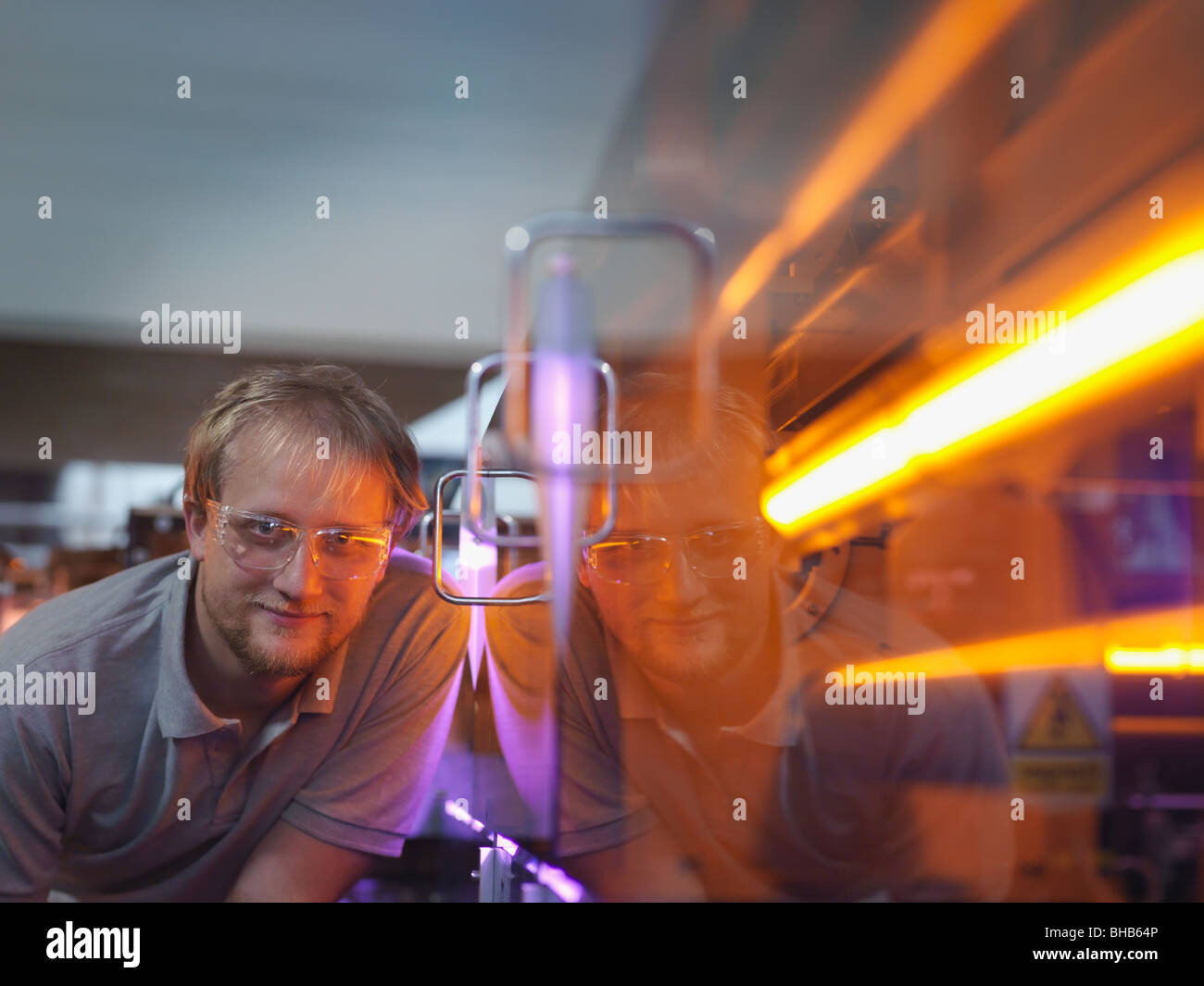 Fusion Reactor Scientist With Laser - Stock Image