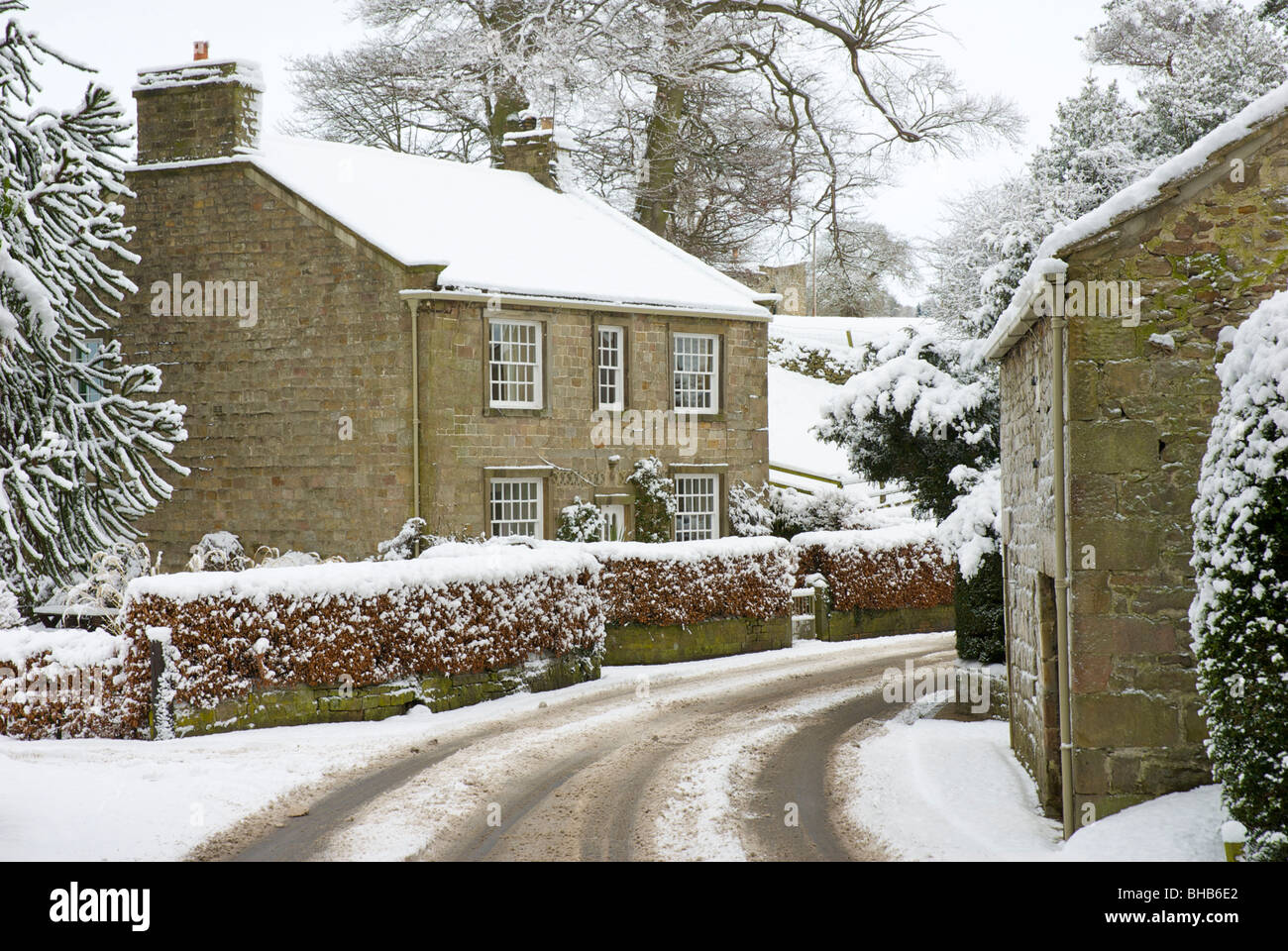 Snowy cottages in the village of Bolton Abbey, Wharfedale, North Yorkshire, England UK - Stock Image