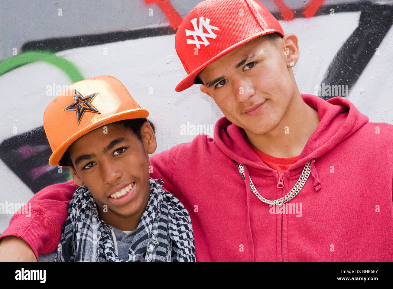 Hispanic and Black Teenagers smiling - Stock Image