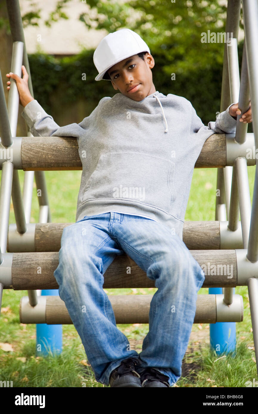 Black Teenager in a park - Stock Image
