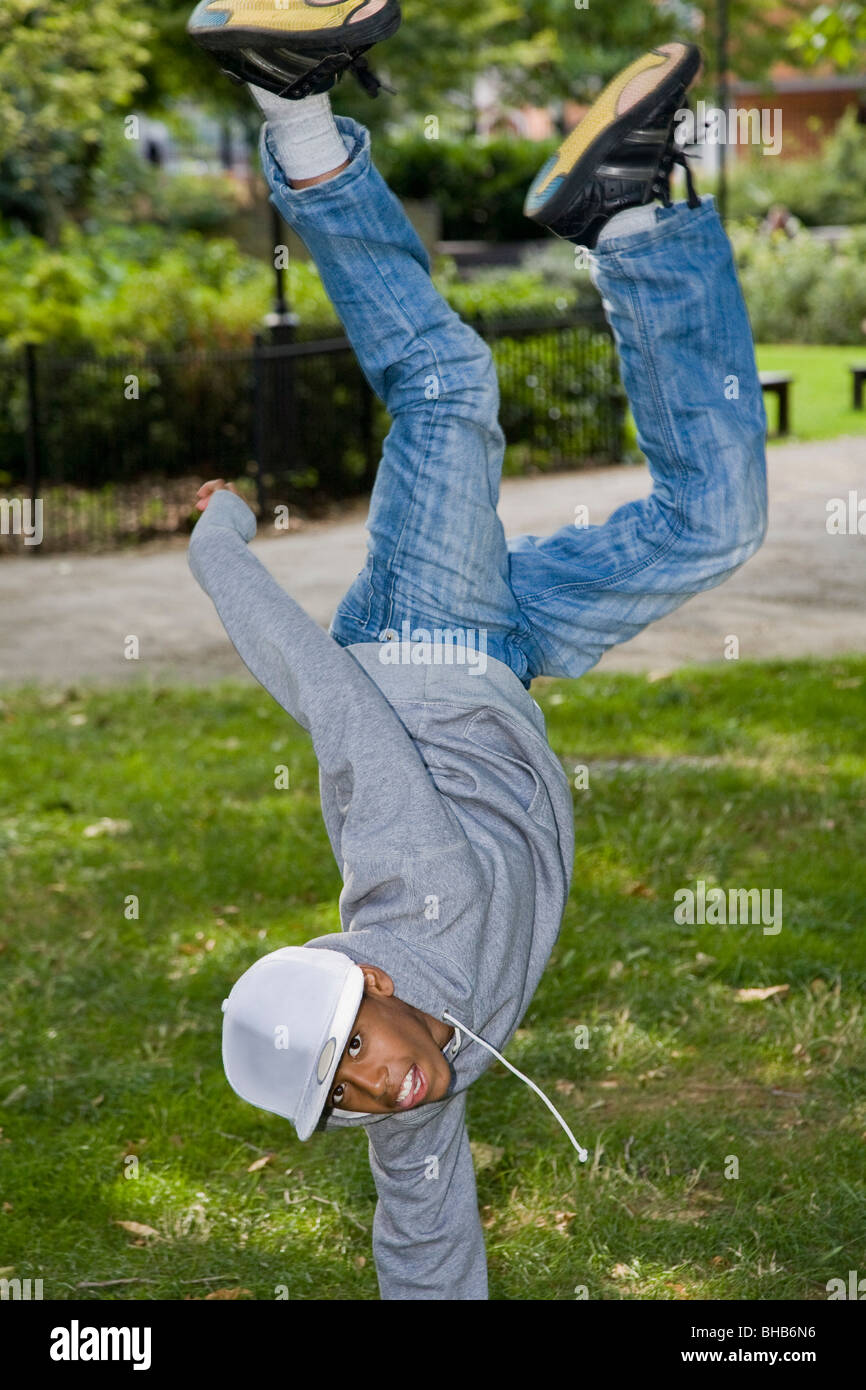 Black Teenager street dancing in park Stock Photo