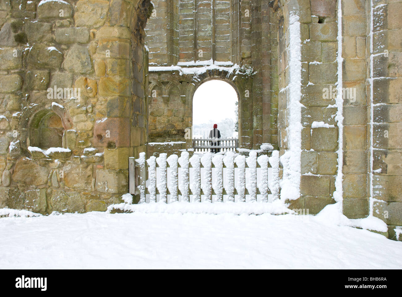 Woman framed by archway, Bolton Abbey, Wharfedale, North Yorkshire, England UK - Stock Image