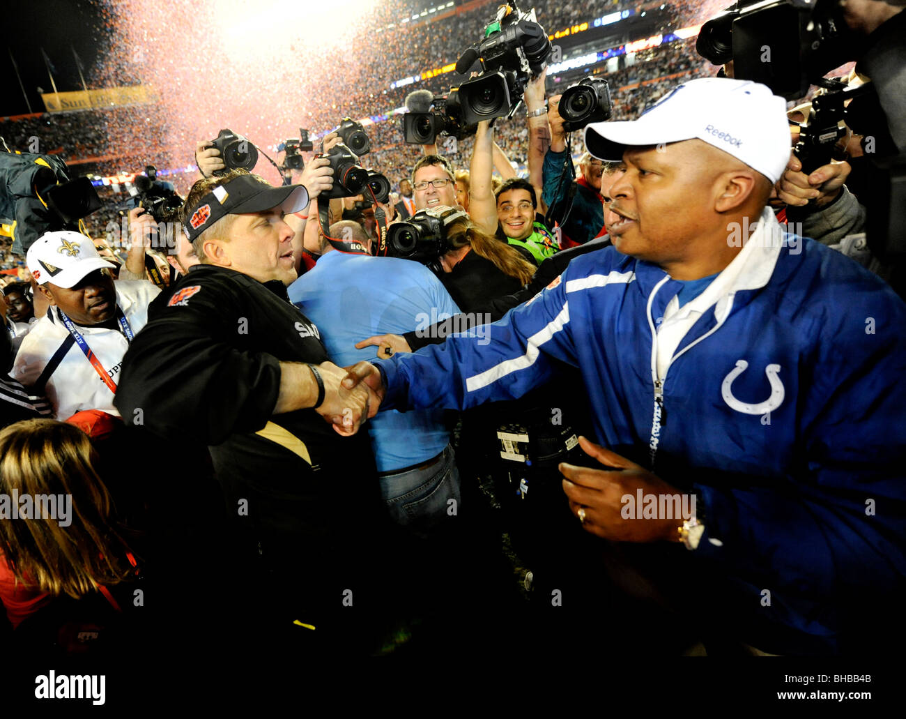 Head coach Sean Payton of the New Orleans Saints shakes hands with Head Coach Jim Caldwell of the Indianapolis Colts - Stock Image