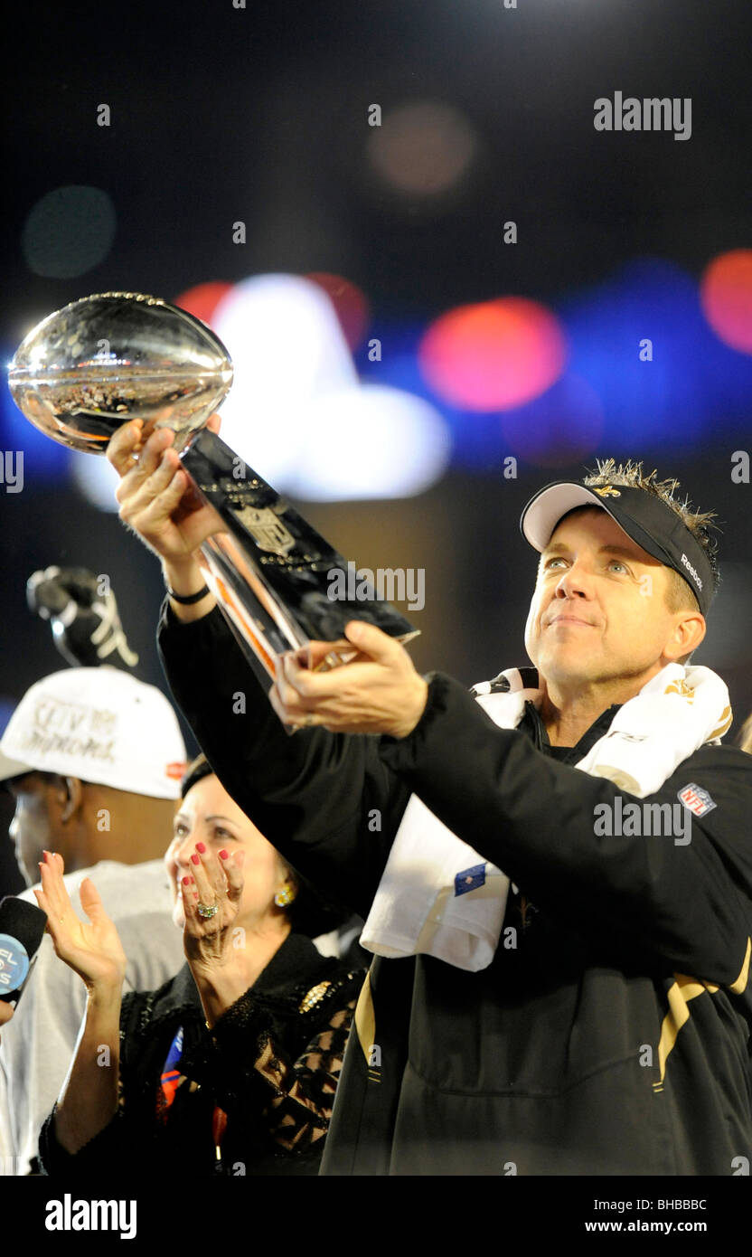 Head coach Sean Payton of the New Orleans Saints celebrates by holding up the Vince Lombardi Trophy at Super Bowl - Stock Image