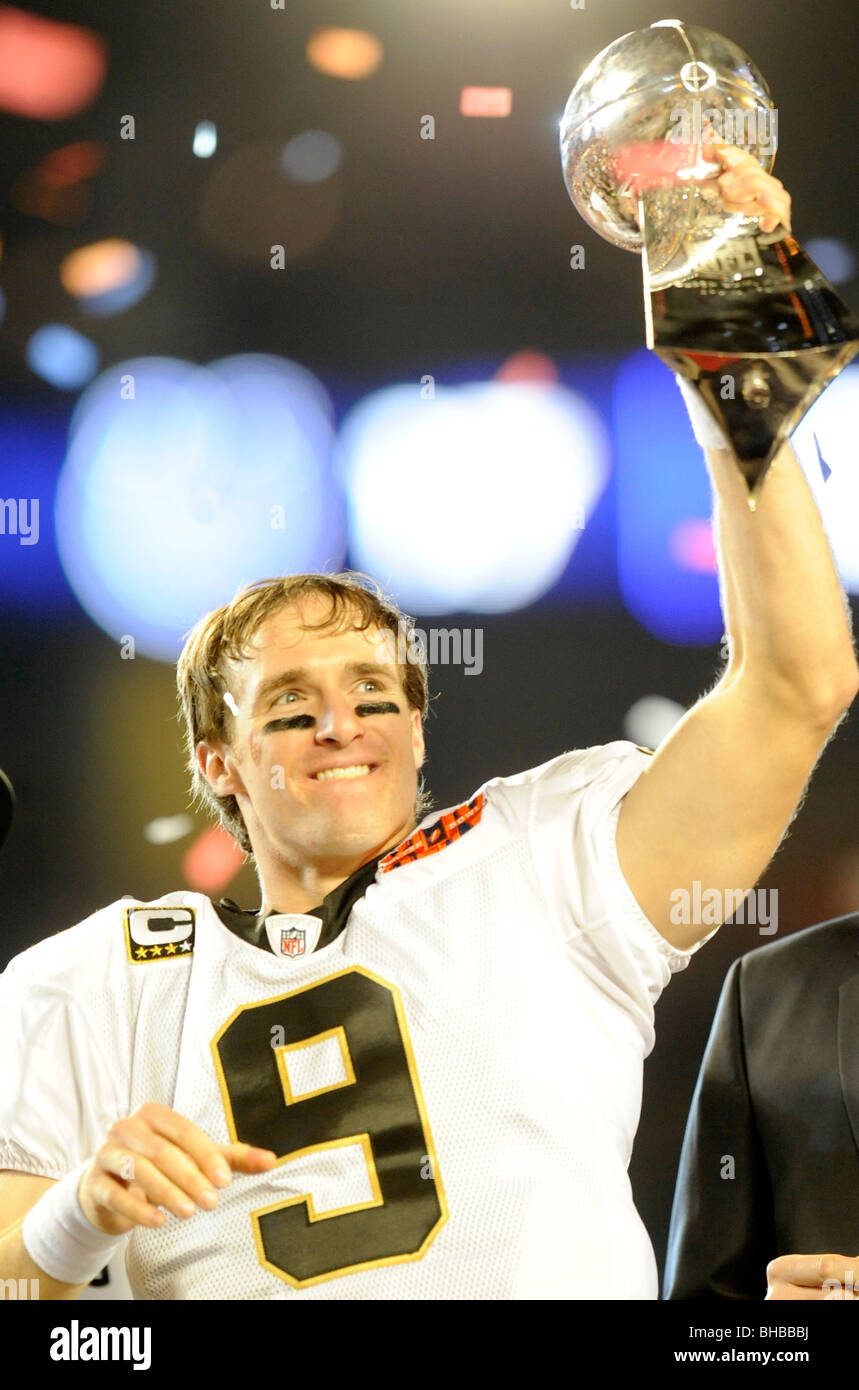 Drew Brees #9 of the New Orleans Saints holds up the Vince Lombardi Trophy at Super Bowl XLIV on February 7, 2010 - Stock Image