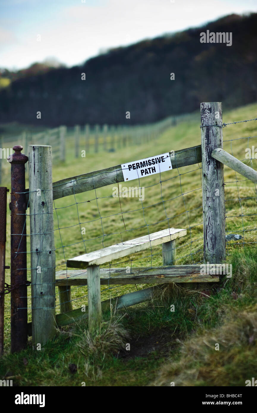 Permissive footpath sign on stile, Wales UK - footpath allowed by landowner, not a statutory right of way - Stock Image