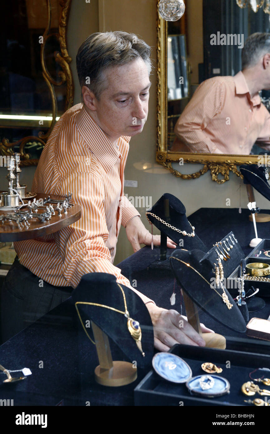 Antique Dealer, Royal Antiques, Royal Street, French Quarter, New Orleans, Louisiana, USA - Stock Image