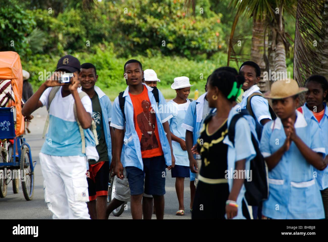 Madagascar January 2010. Secondary school children walking to class - Stock Image