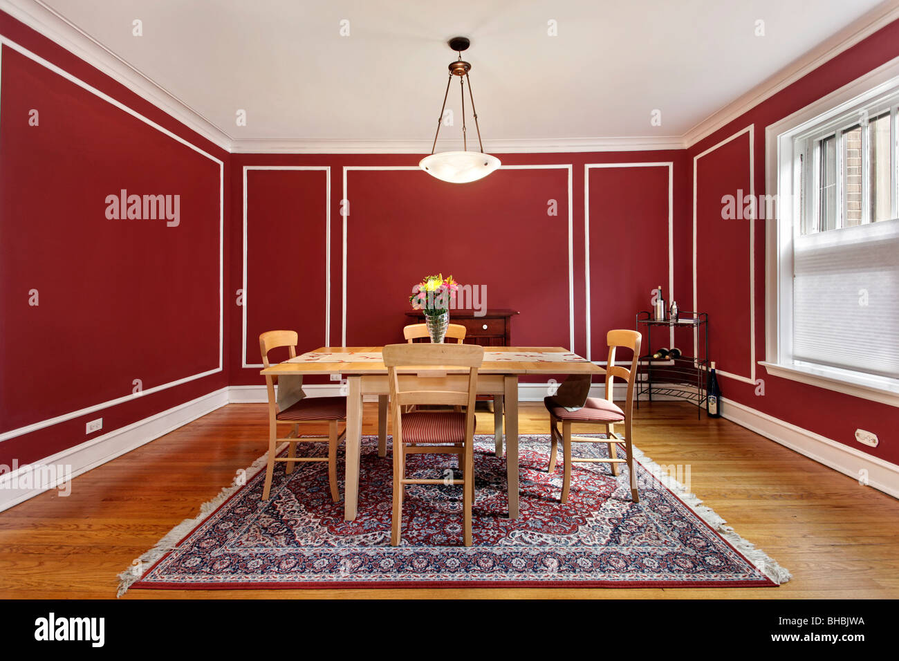 Dining Room In Condo With Red Walls Stock Photo: 27915814 ...