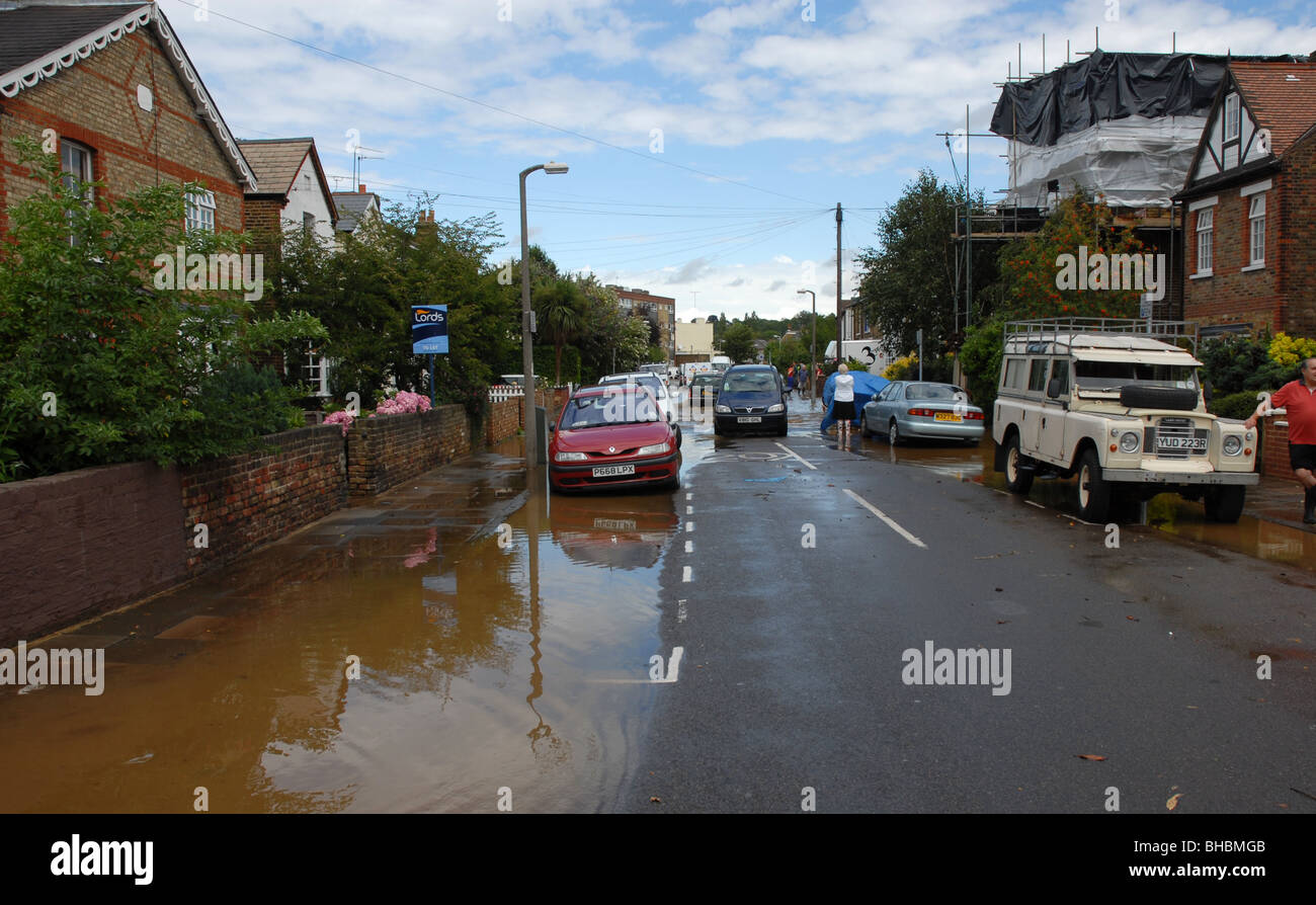 Suburban street as flood recedes Stock Photo