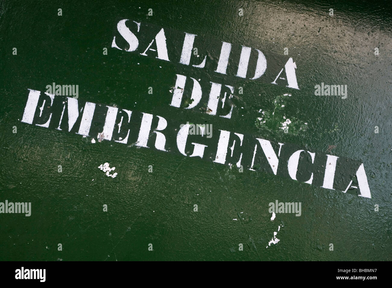 A sign clearly marks an emergency exit in the town of Puerto de la Cruz on the island of Tenerife. - Stock Image