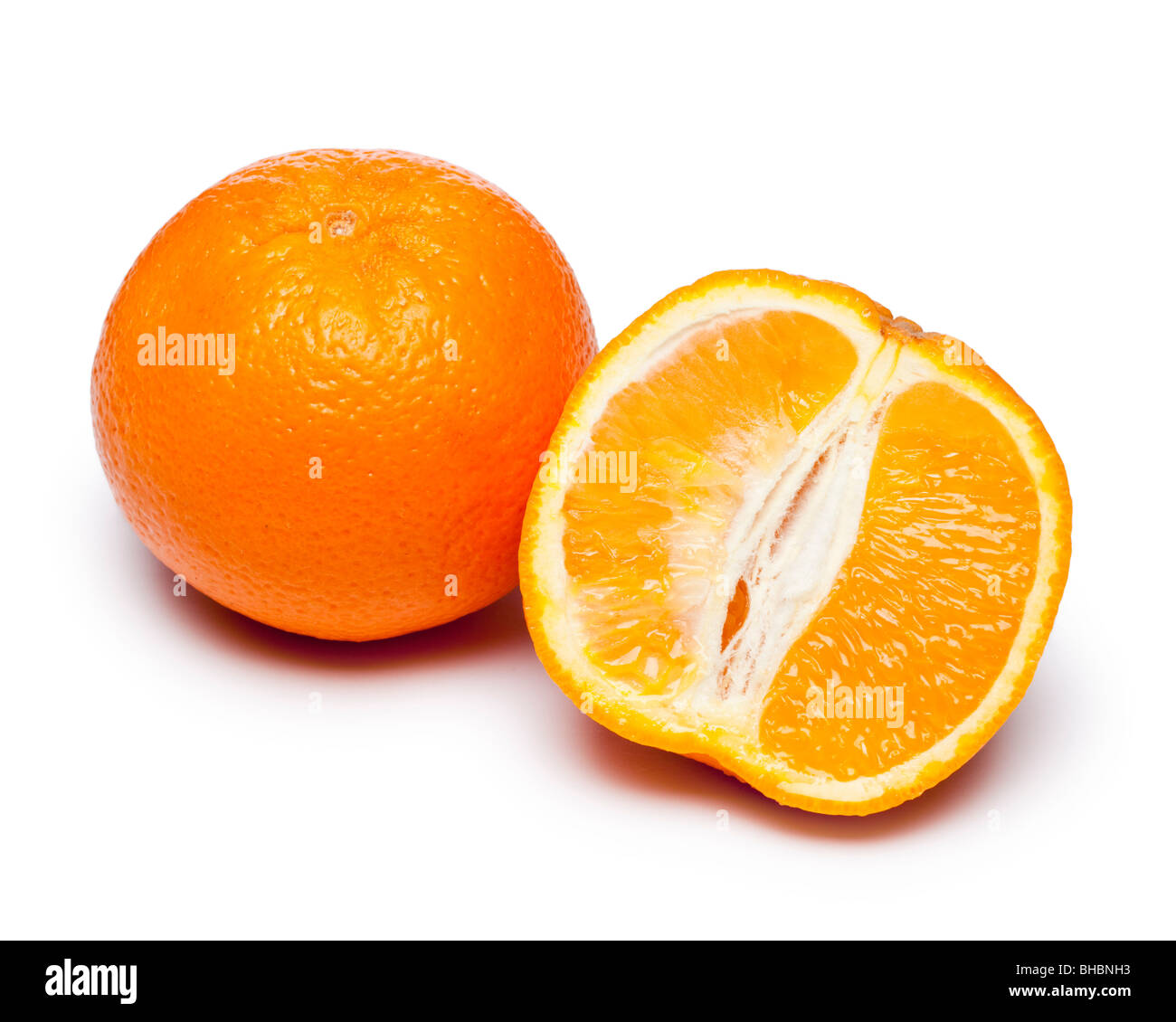 Oranges whole and halved - Stock Image