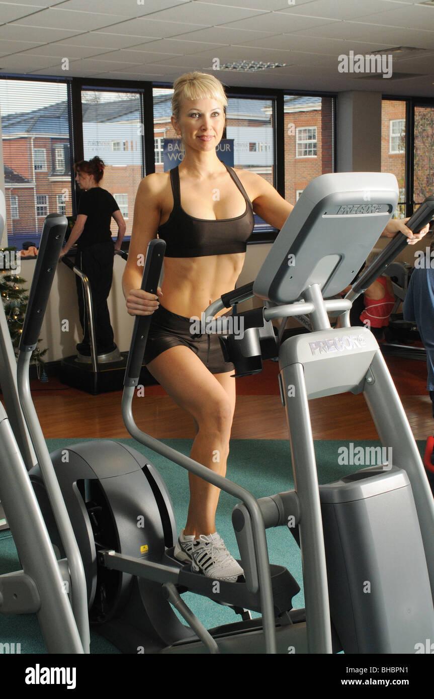 Girl on Cross trainer Stock Photo - Alamy