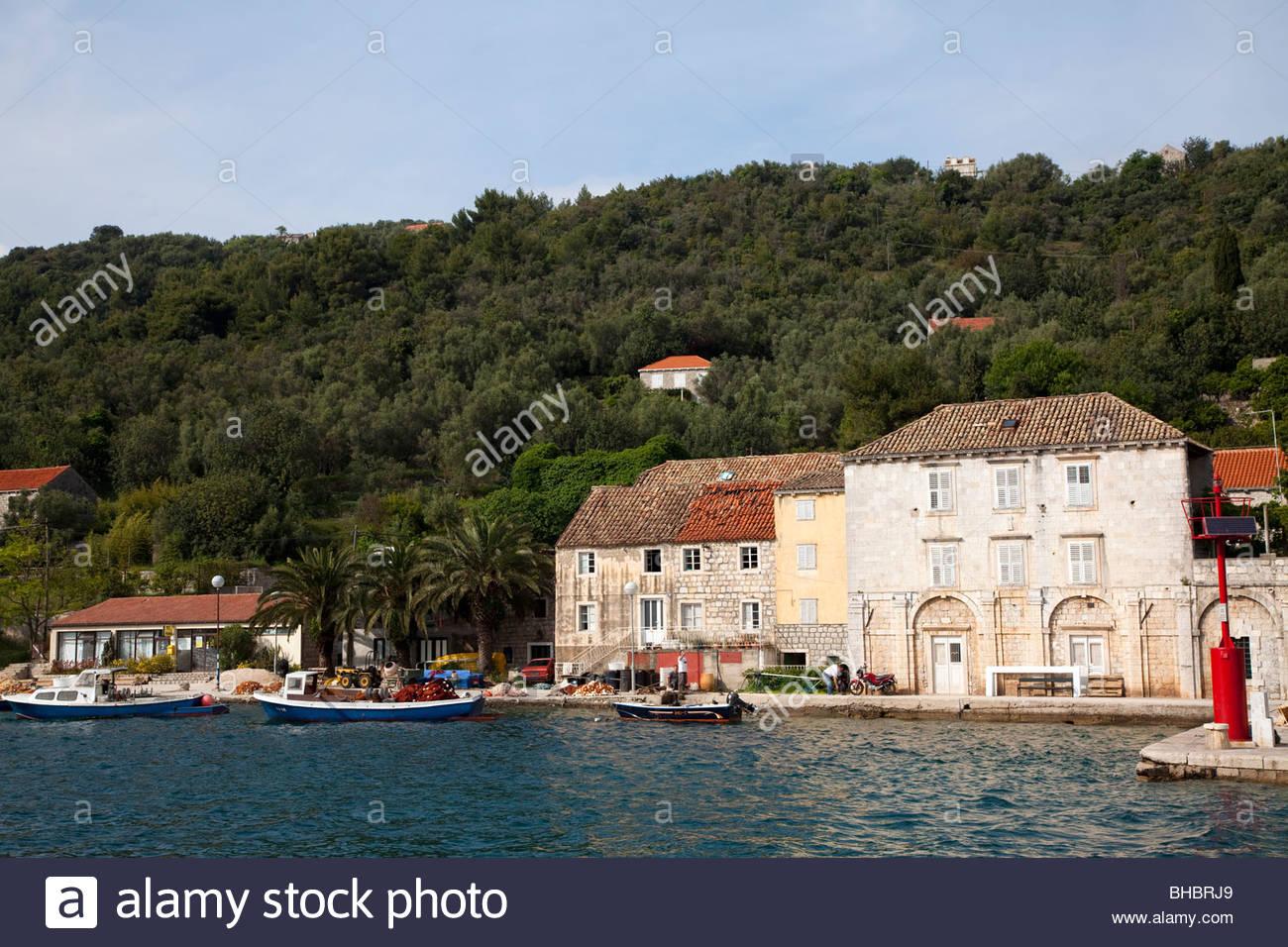 Adriatic Balkan boat boats Croatia Dalmatian Coast Europe European harbour human humans island Luka Sipanska Mediterranean - Stock Image