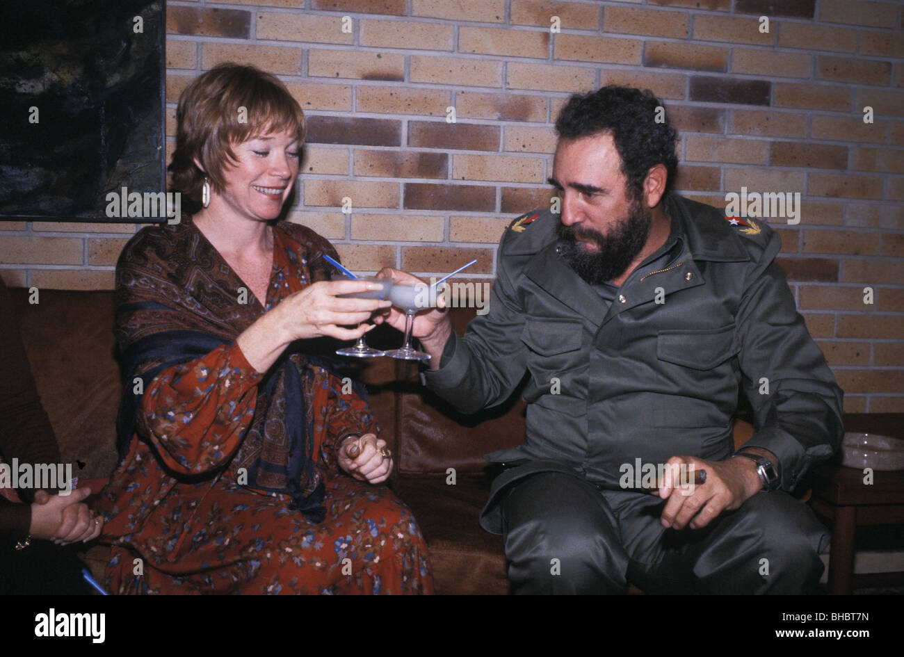 Fidel Castro and Shirley MacLaine share drink in Presidential palace Havana Cuba 1978 Stock Photo