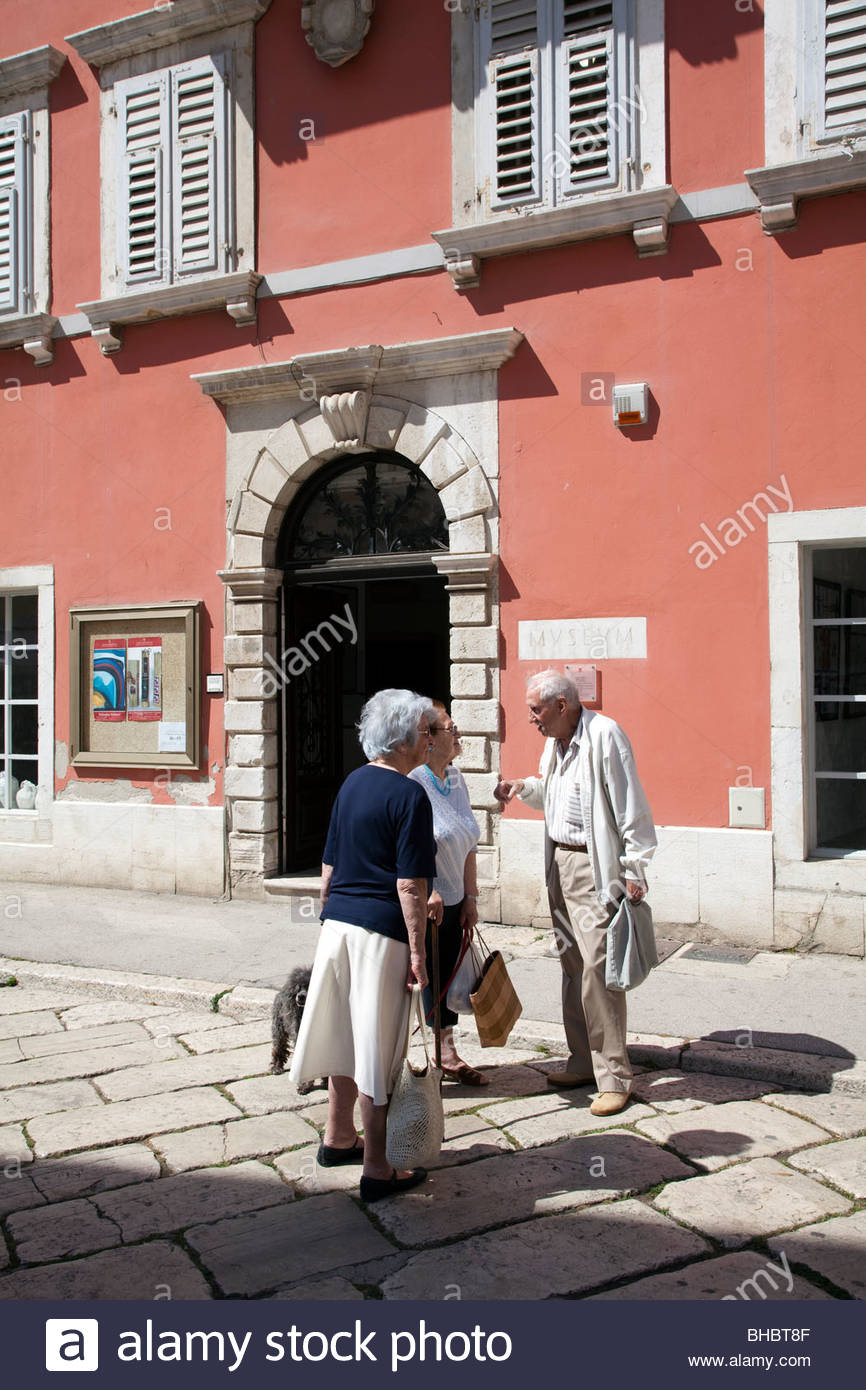 (Multiple values) adult conversation Croatia croatian elderly Istria man Mediterranean museum old People retired - Stock Image