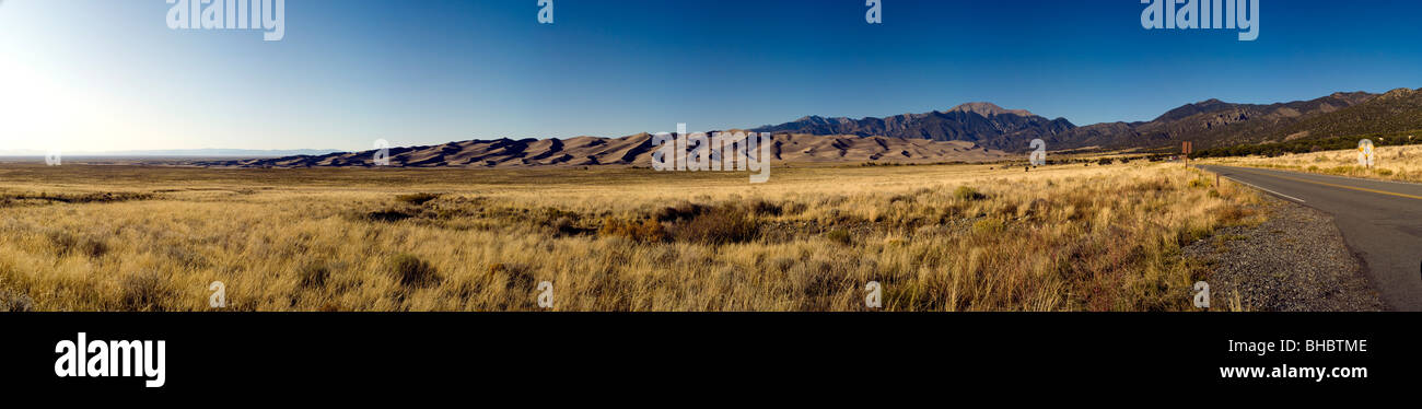A wide panoramic view of the Grate Sand Dunes National Park and Preserve in Colorado, USA. This is a photo from - Stock Image