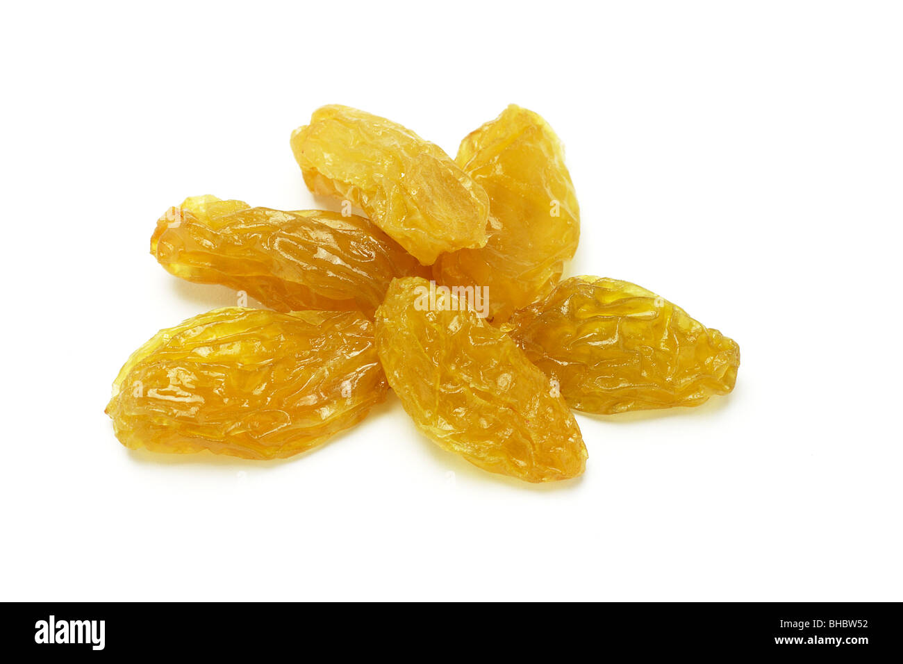 Golden jumbo size raisins on white background - Stock Image