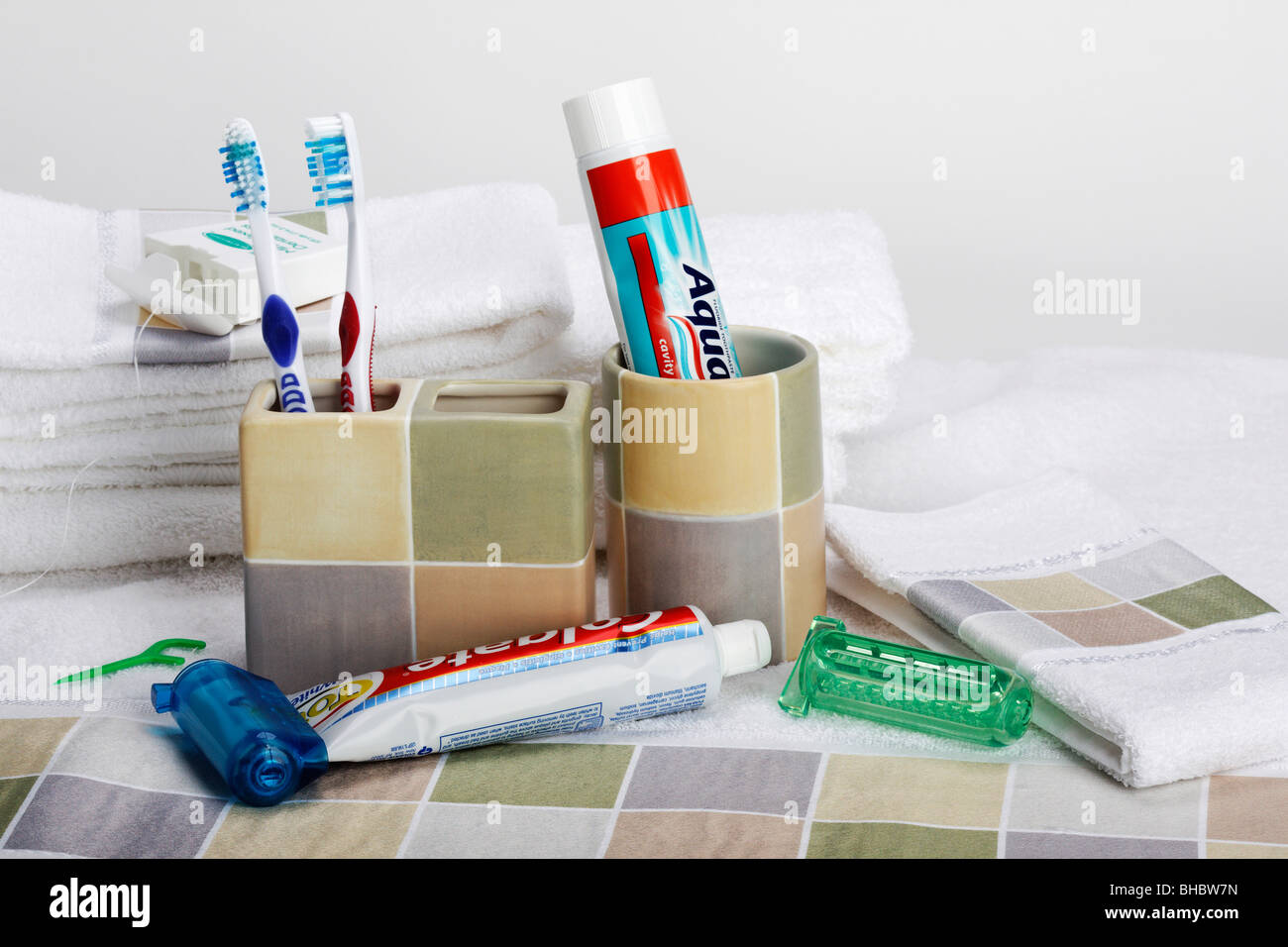 Toothpaste with Squeezer saver and brush holder from above cut out cutout close up closeup studio nobody no people - Stock Image